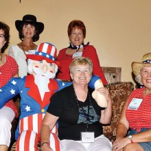 Uncle Sam was a big hit with the ladies. Front row from left: Celeste Kyle, Eileen Sykora and Judy Butler; back row: Pam Coulter and Sandi Beach.