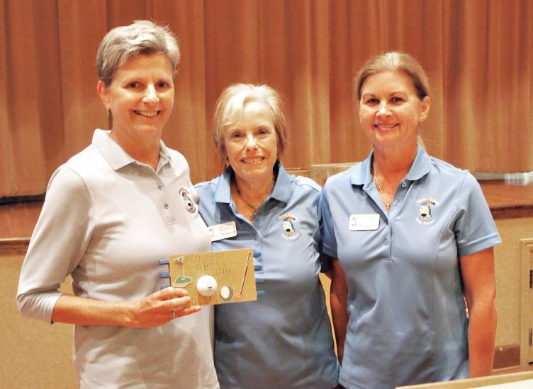 Left to right: Former Putters President Dee Waggoner and Vice President Kelly Hines present the Crystal Golf Ball to Mary Anderson for getting the most holes-in-one; photo by Sylvia Butler.