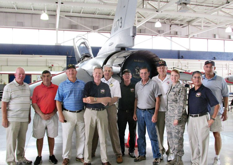 Members of Quail Creek's Veterans Golf Association tour the F-16 pilot training facility at the Tucson International Airport.