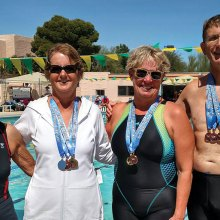 Left to right: Deborah Dunipace, Kathy Stacken, Coach Joannie Eastridge, Steve Huhta