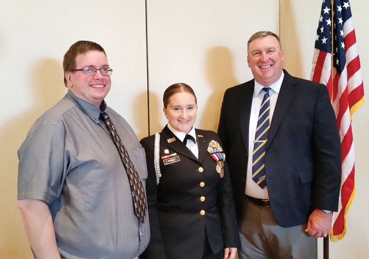 Left to right: Brian Hensley is all smiles upon learning that his daughter, Cadet Commander Kayla Hensley, Sahuarita High School Navy JROTC, was awarded a scholarship and Commander Brad Roberson, JROTC Advisor; photo by Betty Atwater.
