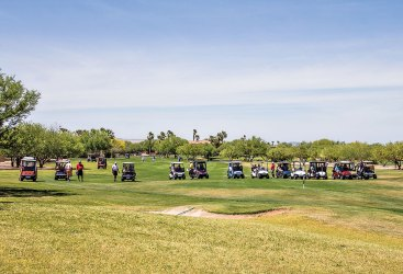 Carts coming up the No. 1 Coyote Fairway involve 12 teams.