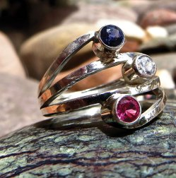 Class Project - Red, white and blue faceted ring