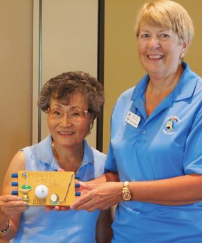 Left to right: Yoshie Hennessy is presented the plaque for the low gross score by Putters Vice President Janet Wegner; photo by Sylvia Butler.