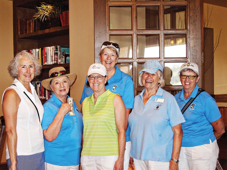Left to right, front row: Chris Gould congratulates Frieda Hyles, Rose Welliver and Neila Kozel for getting two or more holes-on-one with Cathy Thiele also offering her congratulations; second row: Janet Wegner also got two holes-in-one; photo by Sylvia Butler