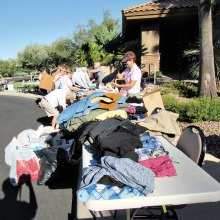 Volunteers sort men's clothing during last year's drive. Photo by Eileen Sykora