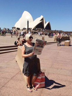 Judith Olsen and Phil Wade recently sunned in Sydney, Australia while enjoying their copy of the Crossing.