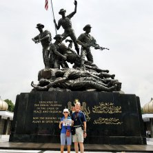 For their 50th anniversary, John and Peggy McGee took a cruise from Bali to Bangkok. They pulled out their Quail Creek Crossing in front of the Victory monument in Jakarta, Indonesia. After living in dry Arizona for 14 years, the 90% humidity really knocked us out!