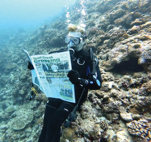 Jan Harris reads her Crossing at 45' while visiting the Kerama Islands of Okinawa, Japan.