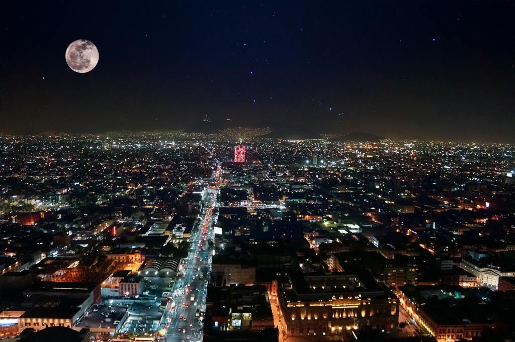 """<img src=""""mexicocity.jpg"""" alt=""""aerial view of Mexico City at night AKA is it safe to travel in Latin America?"""">"""