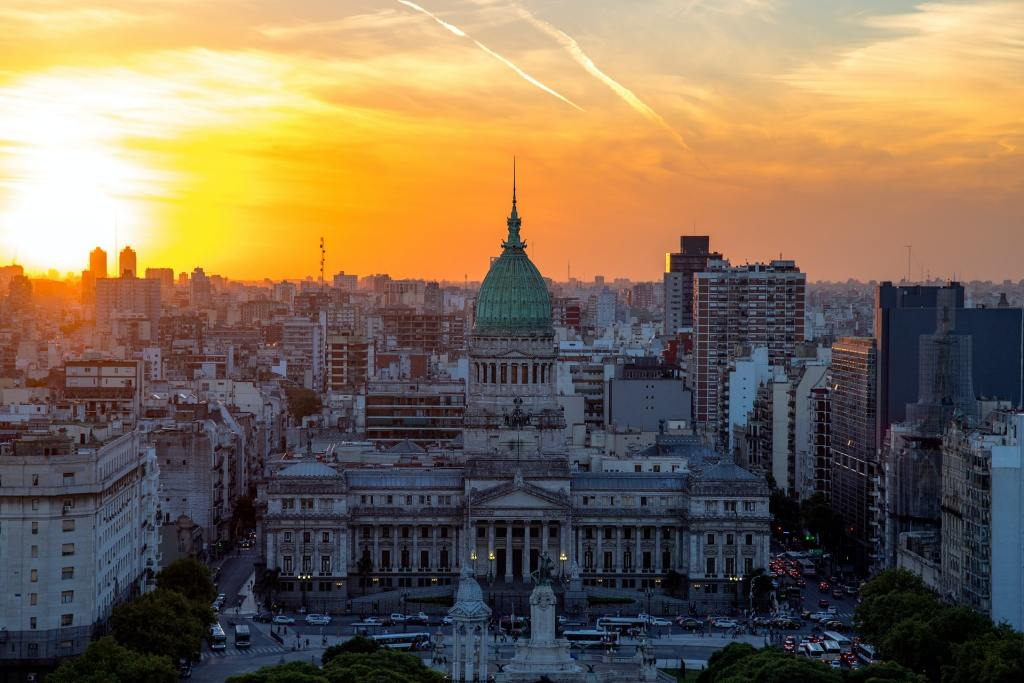 """<img src=""""congreso.jpg"""" alt=""""a building of Argentinian Congress and the city of Buenos Aires during the sunset AKA is it safe to travel in Latin America?"""">"""