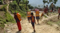 Carrying rice to their shelters.