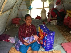 Maji Tamang of Haku-8 gave birth to a baby boy in this tent. She has three more sons. The baby is a few days old. She received a bag of new mom supplies through Nehi Fund.