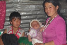 Kali Ghising of Bhorle-3, Rasuwa, with her two children. Her older son is 8 and the younger one is a few weeks old. Their father died when their house collapsed during the April 25 quake. Kali, now a young, single mother, is traumatised by her loss and also worried about how she will raise the two kids.