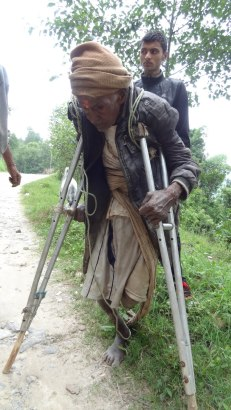 85-year-old Krishna Siwakoti from Rudrawati VDC. Lame and blind in one eye. He had come alone to Babare to collect relief as he has no family. He was planning to use that rope to carry supplies on his back. We gave him 1000 rupees so he can hire a porter and buy some food.