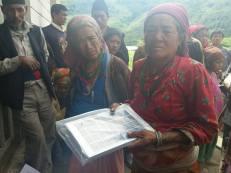 Locals in Alampu receiving solar lamps