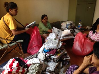Team members sorting used clothes for donation