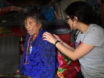 Dr Sritika Thapa with an elderly patient who couldn't walk up to the health camp site