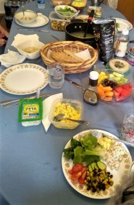 Table set with food for a potluck lunch.