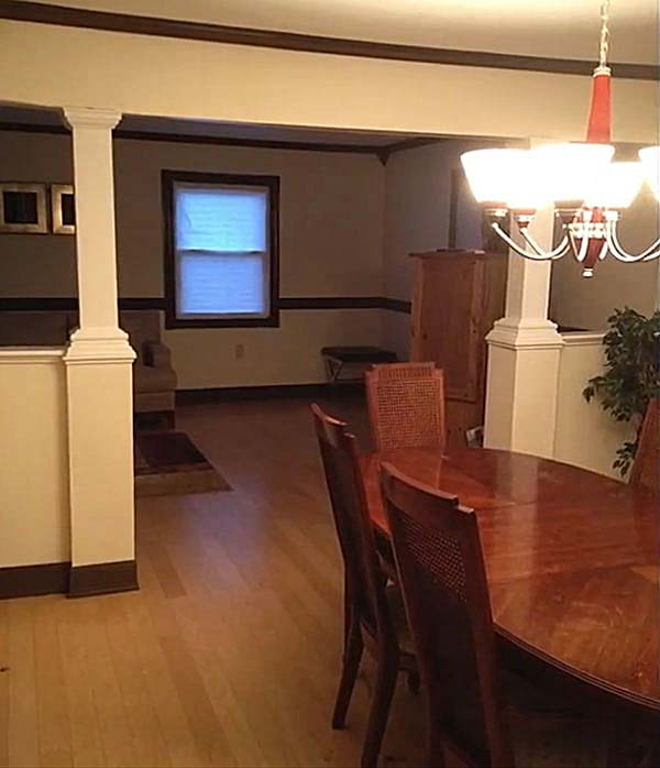 Pillars and open walls in dining room remodel by Qualis Construction