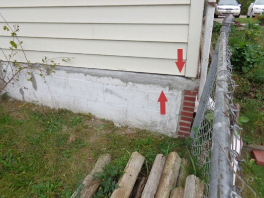 Quality Foundation Repair - Note the large grey patch job with the foundation issues not being addressed