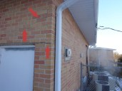 Quality Foundation Repair - Note the stair step cracks and the crack in the corner