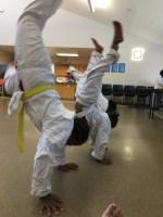 Kids practicing handstands