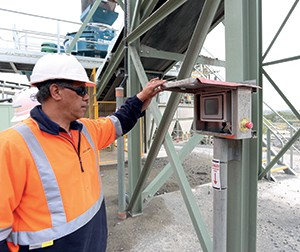 Quarry manager Shane Toto at the small control box of the automated new plant that replaces the traditional row of buttons.