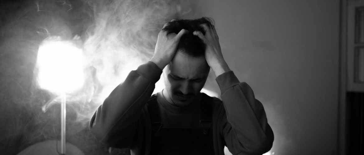frustrated man with hands on head