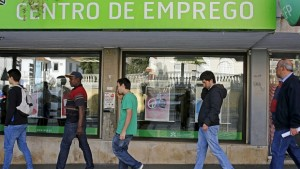 Jobless workers queue at the employment centre to open in Sintra, Portugal, in May 2015, where the unemployment rate neared 14 per cent and is almost double that for young people. REUTERS