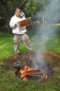 Mark H. Creighton burning infested frames of brood from a Langstroth beehive. (Photo courtesy of Mark Creighton)