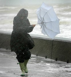 As the South Coast of England is battered by wind and rain this walker does her best to survive the elements on the seafront of Saltdean near Brighton words Phil Mills 07792308210) (website usage by negotiation 07976504832)