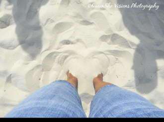 Both Feet in Sand