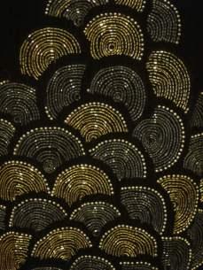 Fabric detail black theatre coat