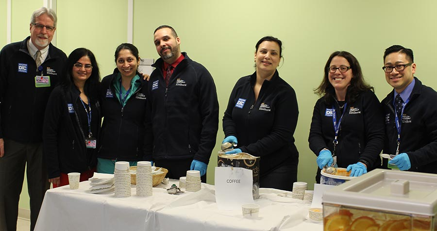 """An """"Ice Cream Social"""" hosted by representatives of the Doctors Council and senior members of the hospital's administration and medical staff, including, l. to r.,  COO Wayne Zimmermann, Drs. Isha Mehta and Jasmine Dave, CFO David Guzman, Chief Implementation Officer Jeannith Michelen, Dr. Suzanne Bentley, and Patient Experience Officer Pierre Pham."""