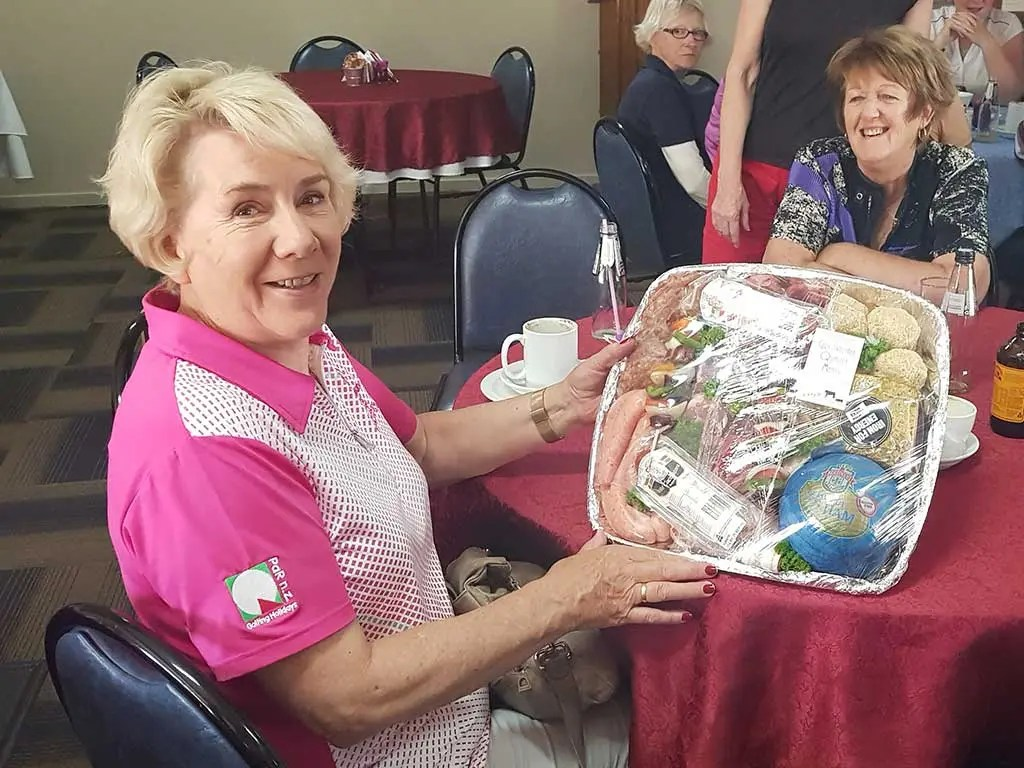 Faye Knight Accepts the Meat Tray for Marg Storey
