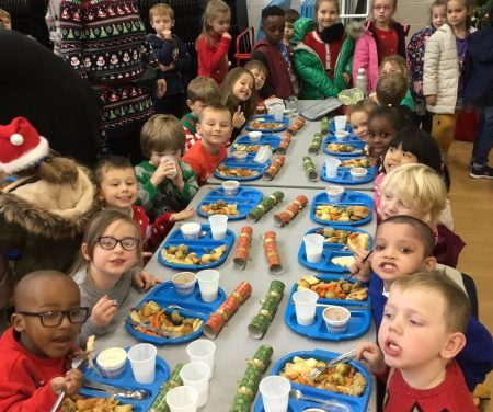 Children enjoying their Christmas lunch.