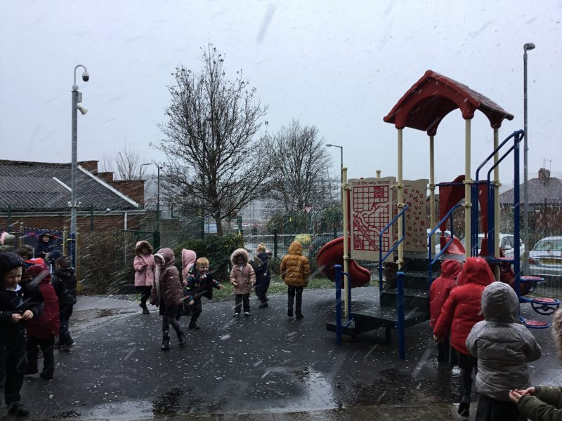 Foundation Stage outside in the snow learning about their new topic 'winter'