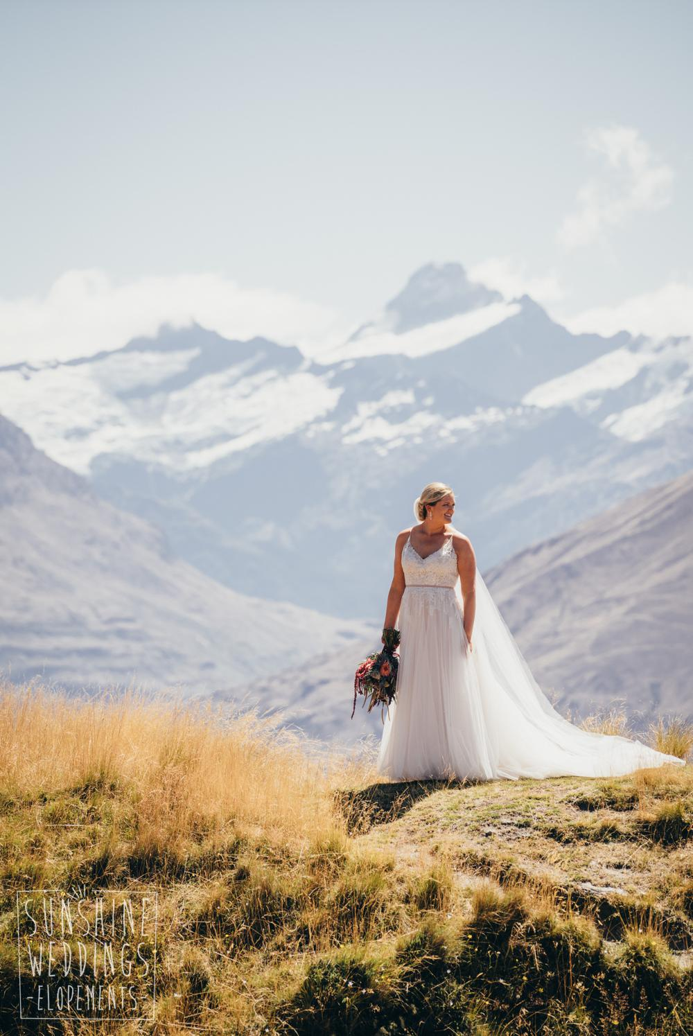 bride on mount roy with mount aspiring in background