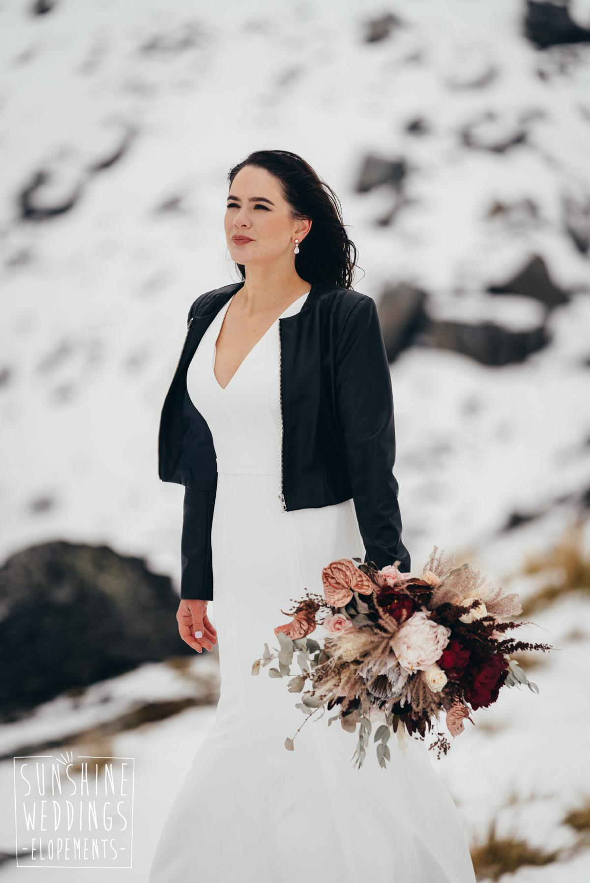 bride in snow on a mountain