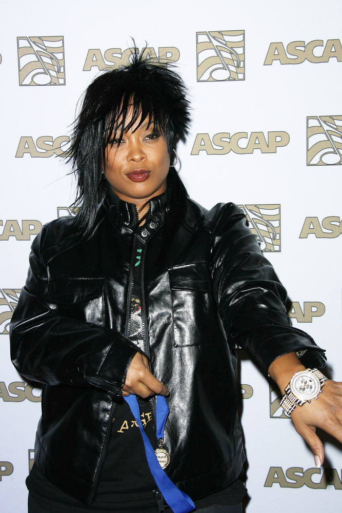 """Da Brat Promotes Girlfriend BB Judy Hair Products Kaleidoscope In Her Remake of """"That's What I'm Looking For"""" Song"""
