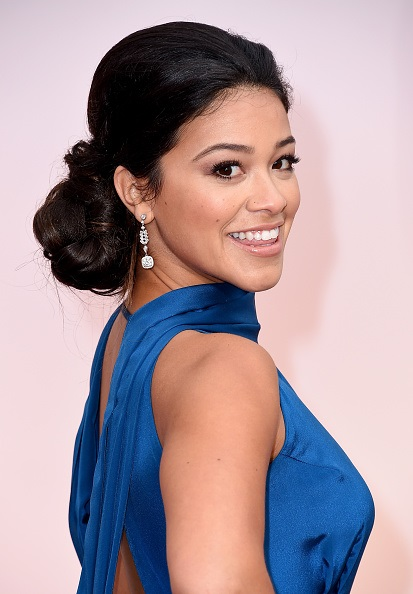Gina Rodriguez attends the 87th Annual Academy Awards at Hollywood & Highland Center on February 22, 2015 in Hollywood, California.   Courtesy of John Frieda Hair Care