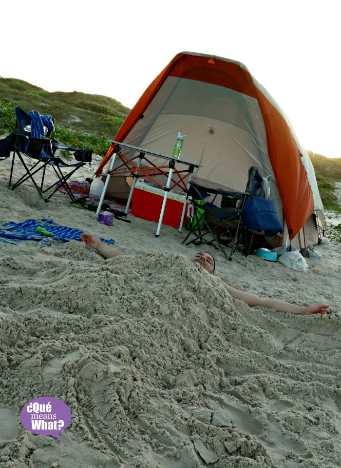 Buried in the Sand - Beach Camping - QueMeansWhat.com