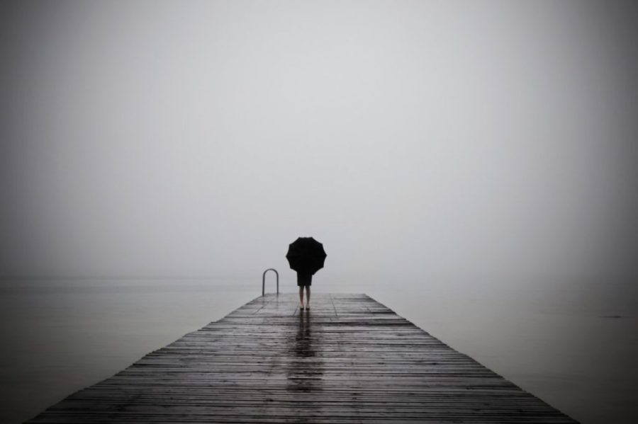 rain and fog at the end of a pier