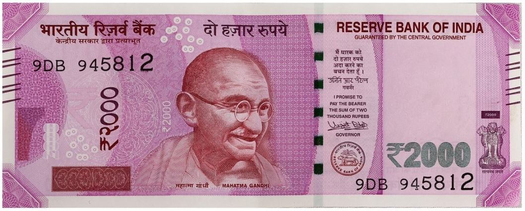 what does millennial mean and why it doesn't matter image of 2000 rupee note and ghandi
