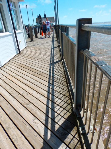 Plaques on the hand rail - Southwold