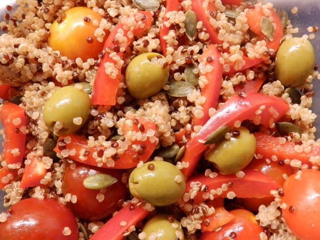 Quinoa, tomatoes, olives, red peppers, pumpkin seeds with Balsamic vinegar. My fridge is far too healthy.