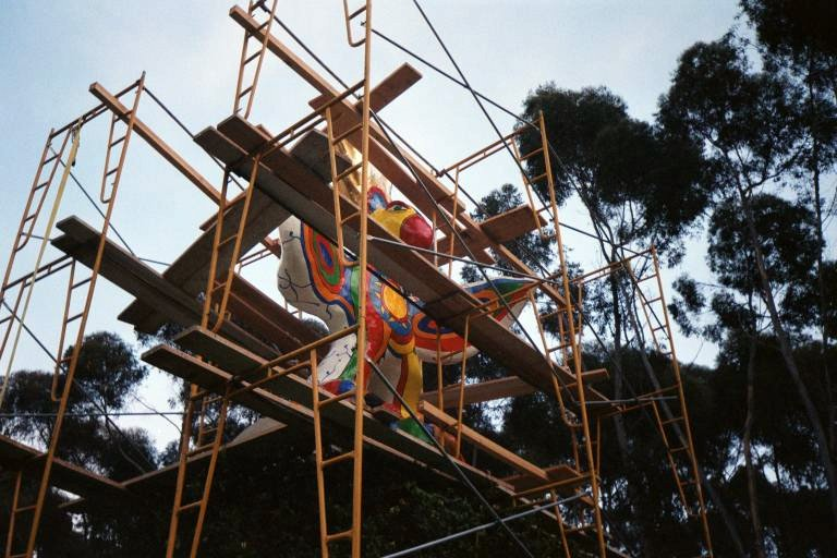 Scaffolding is in place around the Sun God sculpture at UC San Diego at some point during my time there before 2000.
