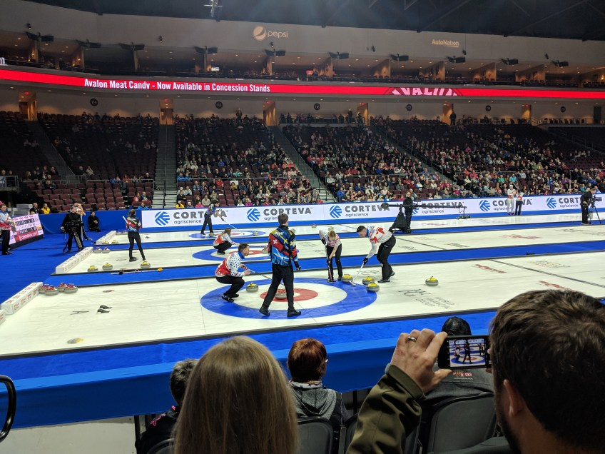 On the closest sheet, Team North America (skipped by Brad Gushue) sweeps a stone into the house against Team World, lead by Bruce Mouat, during the 2019 Continental Cup on Saturday, Jan. 19, 2019, in Las Vegas, Nevada.