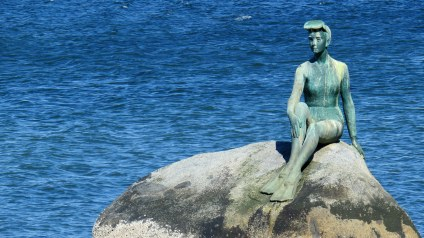 """""""Girl in a wetsuit"""". From afar I thought it was the Little Mermaid (just like the one in Denmark)."""